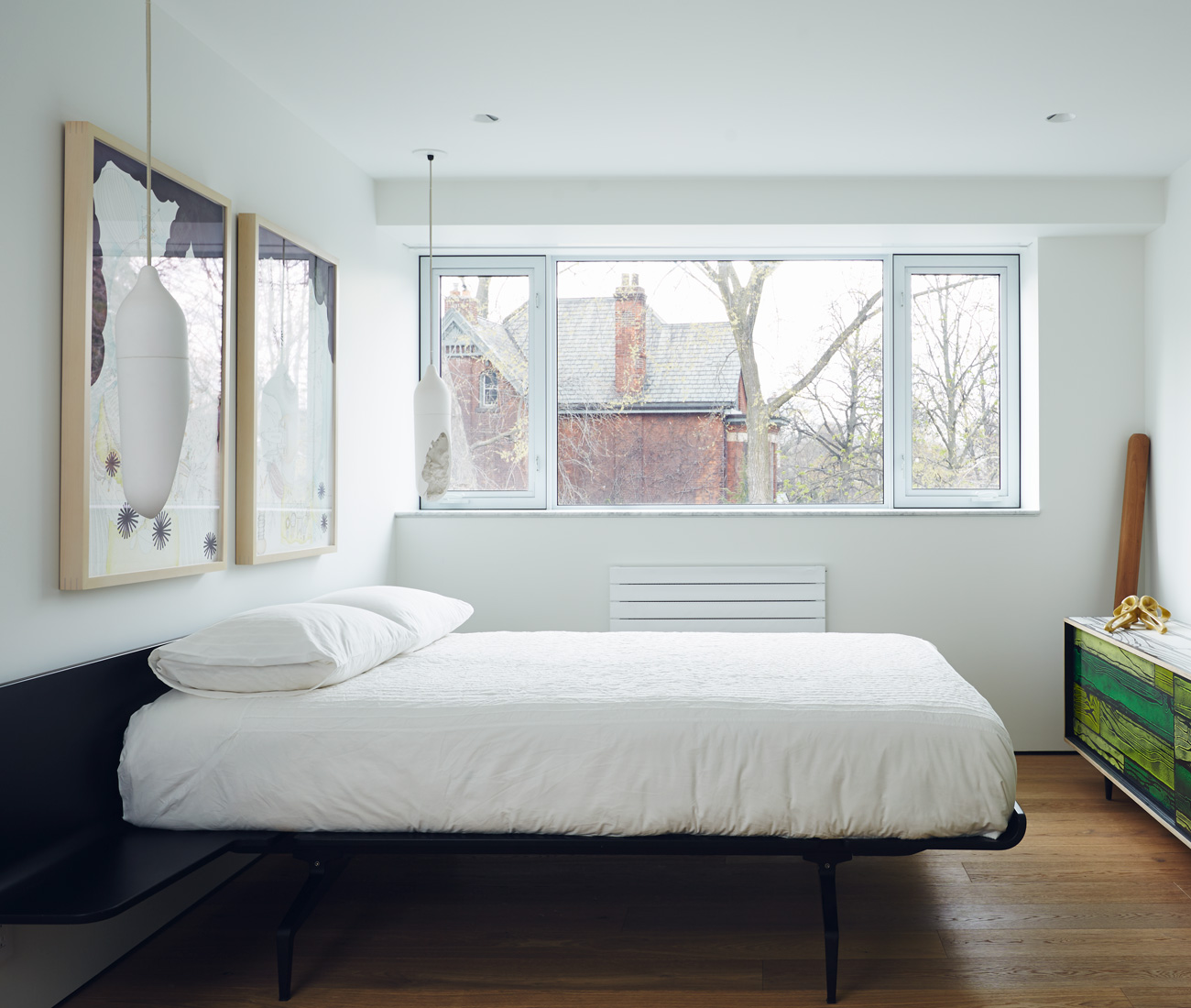 In the master bedroom: bed by Legnoletto; cabinet by Established & Sons; photo by Timothy Saccenti. Photo by Michael Graydon.
