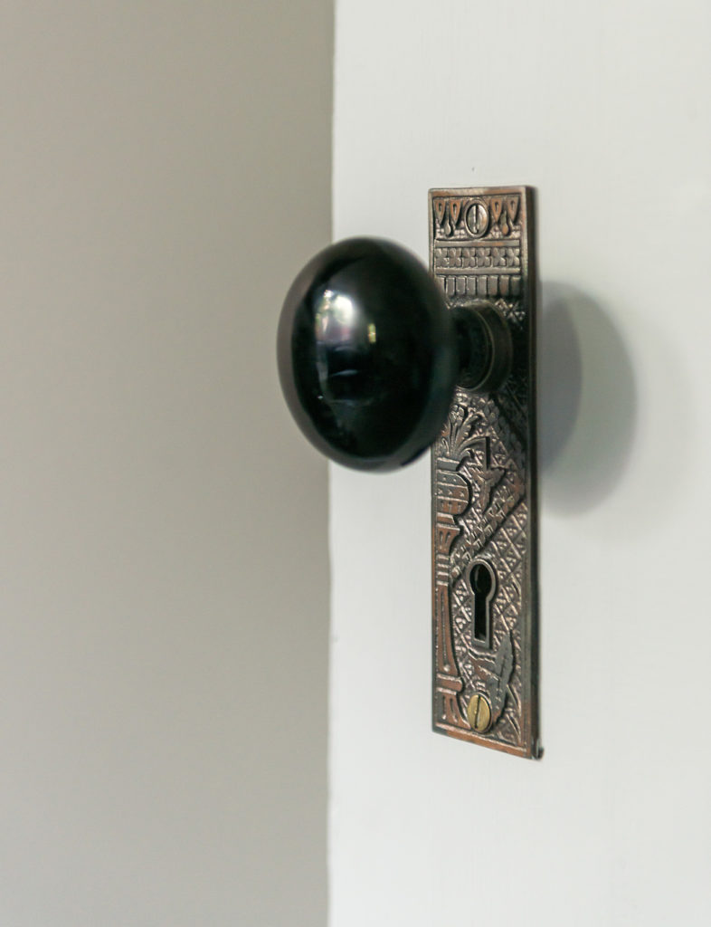 Every William Morris-style grate, hinge and mortise lock was restored.