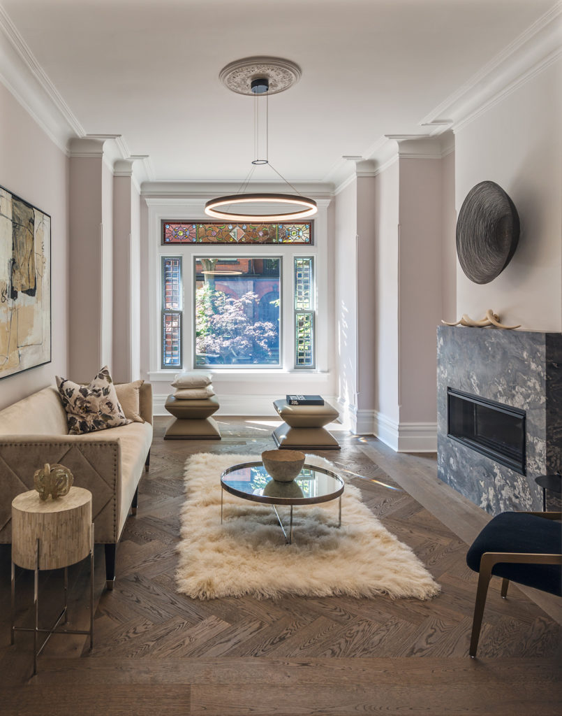 Original mouldings and leaded glass were restored. Flooring with custom herringbone pattern by Moncer; pendant from Sescolite; stools from Cocoon Furnishings.