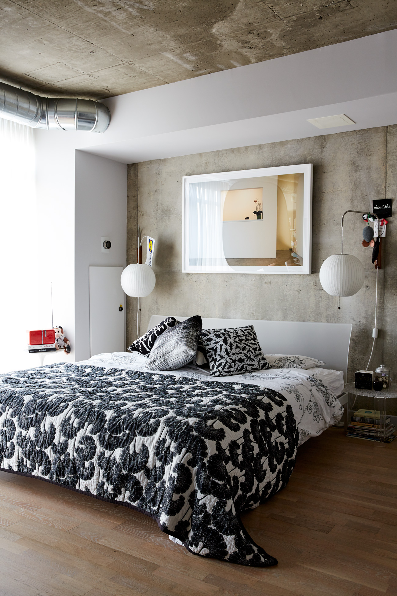 Also on the first floor, George Nelson sconces are installed on either side of the master bed, amped up by a bold Kate Spade coverlet.