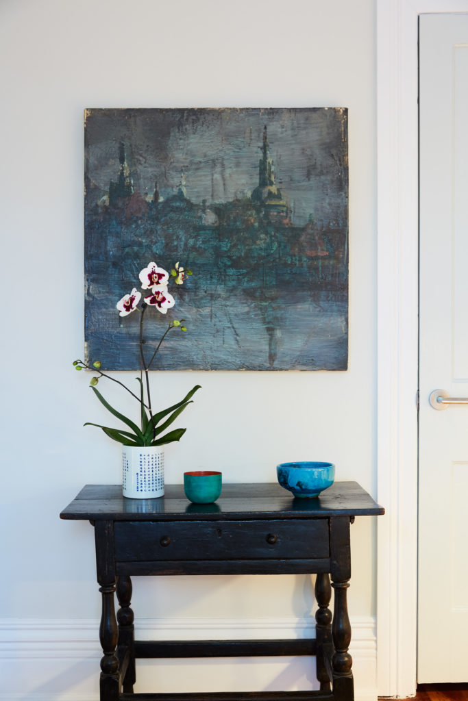 Above the 19th century English Tavern Table hangs an encaustic painting by Tony Scherman.