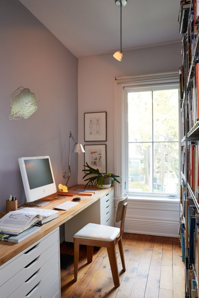 In his studio, filing cabinets are bridged with a butcher block. Above the desk is an Artemide task light and Micah Lexier's A Minute of My Time.