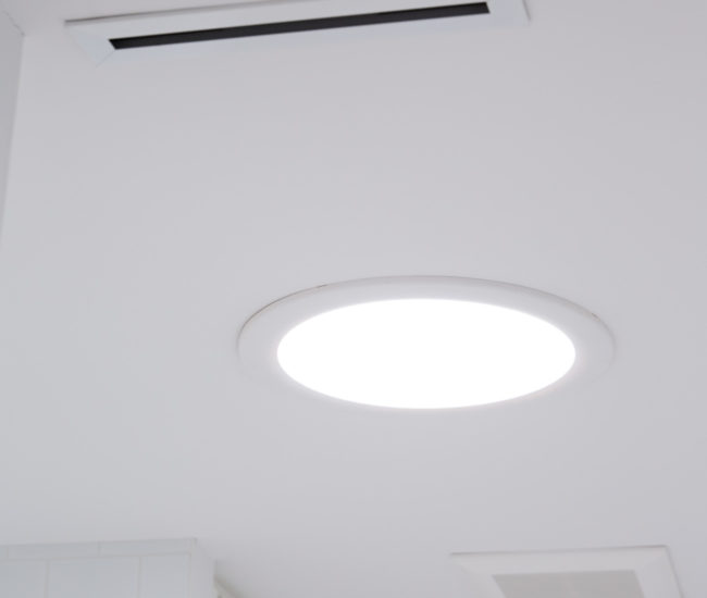 Velux sun tunnels bring ample natural light into the window-less bathrooms and master closet.