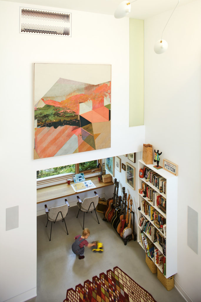 A pocket door closes the office/jam room off from the living room. Above the office, a vertical window illuminates the master bedroom's walk-in closet. Painting by Andy Curlowe.