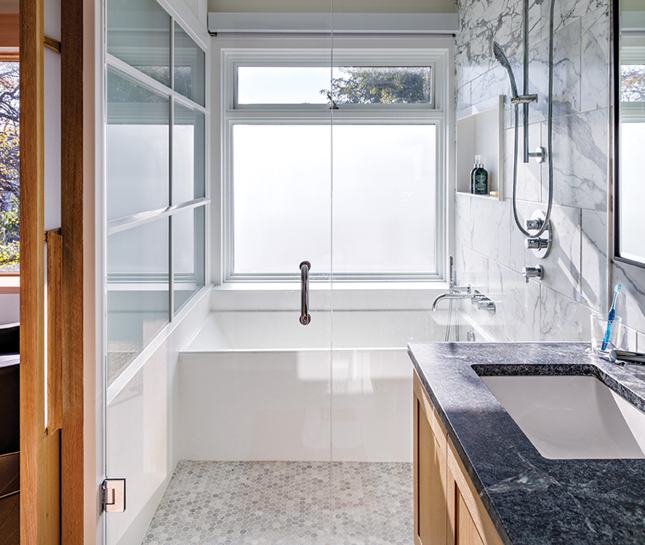Soapstone, Corian and marble fuse in the soft palette of the master bath.