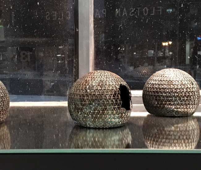 Flotsam Particulates. No, they aren't tiny Death Stars. For this window installation, LeuWebb re-casts another, equally familiar icon into gleaming bronze statuettes: the Ontario Place Cinesphere. We loved seeing this landmark transformed into memorabilia. Bravo for making the architectural spirit of Ontario Place into a collectible. (Swipe Design, 401 Richmond St. W.)