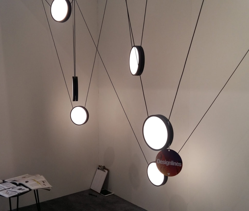 High Wire Lights by Anony. We love how these individually weighted, jewel-like, suspended luminaires add architecture to an empty space. Framing each individual fixture with light  adds a unique character to both the pendants and the space as well.