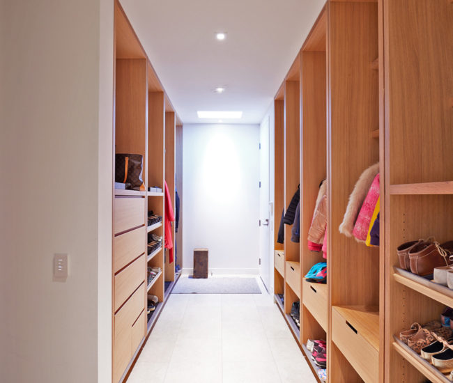 """Ceiling-height """"lockers"""" in white oak provide storage for the family of six. Millwork by Mar-Tec Woodworking."""
