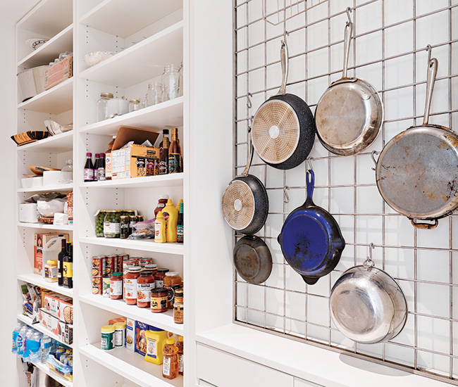 Tucked neatly behind the kitchen is a pantry with direct access to the garage, making dropping off groceries a breeze.