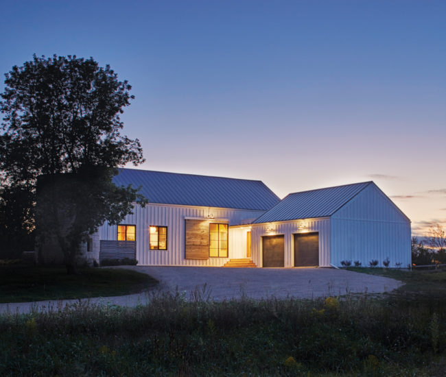 The new home – and the 60-year-old silo it inherited – sits on 1.3 hectares in Erin, Ontario.