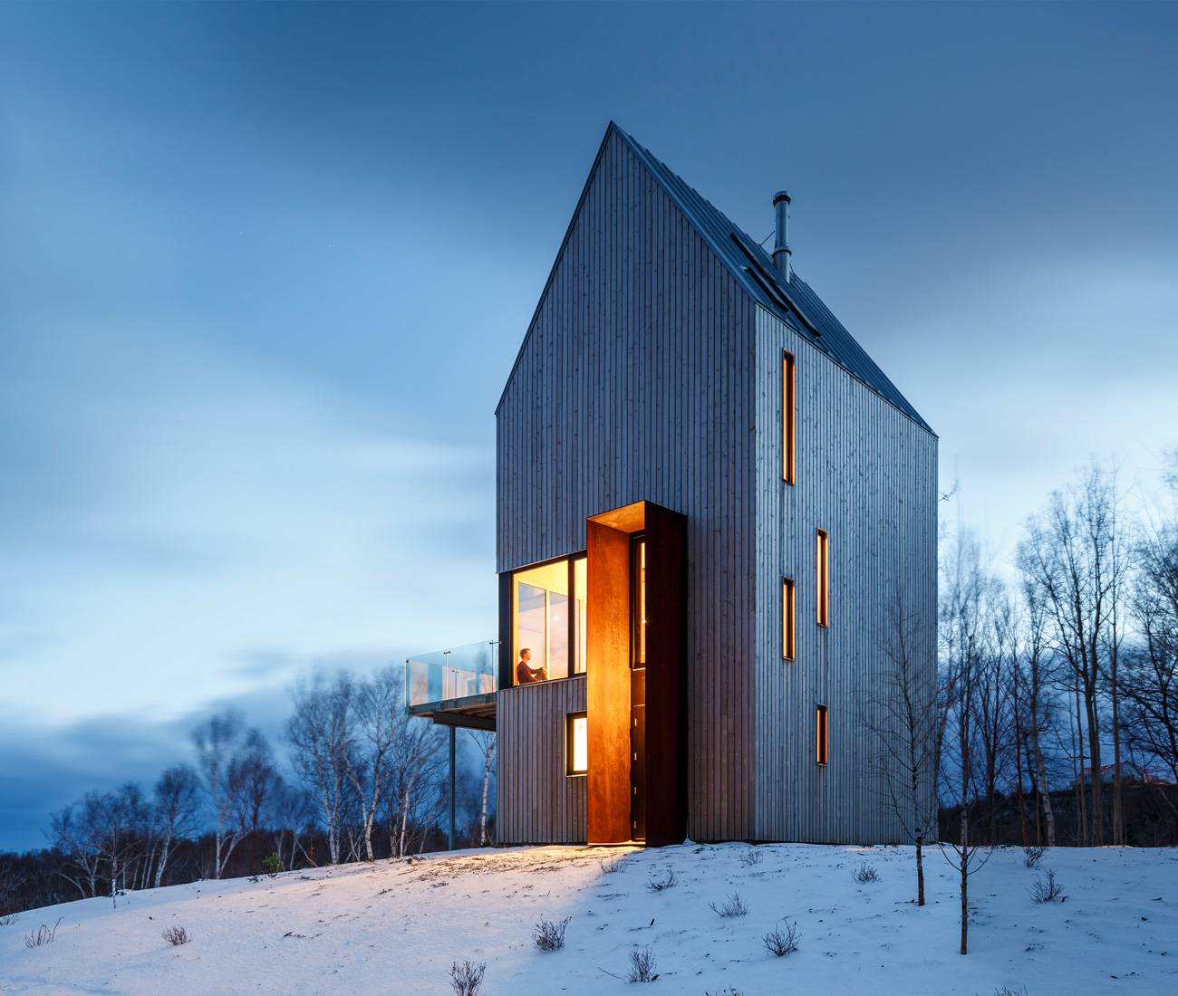 Gandhi's take on the gabled farm-house, the Rabbit Snare Gorge home in Cape Breton, has a two-tonne Corten hoop serving as a windbreak around the entrance.