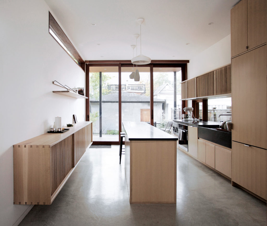 Design, build and millwork by Studio Junction. Lift and slide door by Fusil; windows by Loewen; Marset pendants from LightForm; soapstone from Ciot.