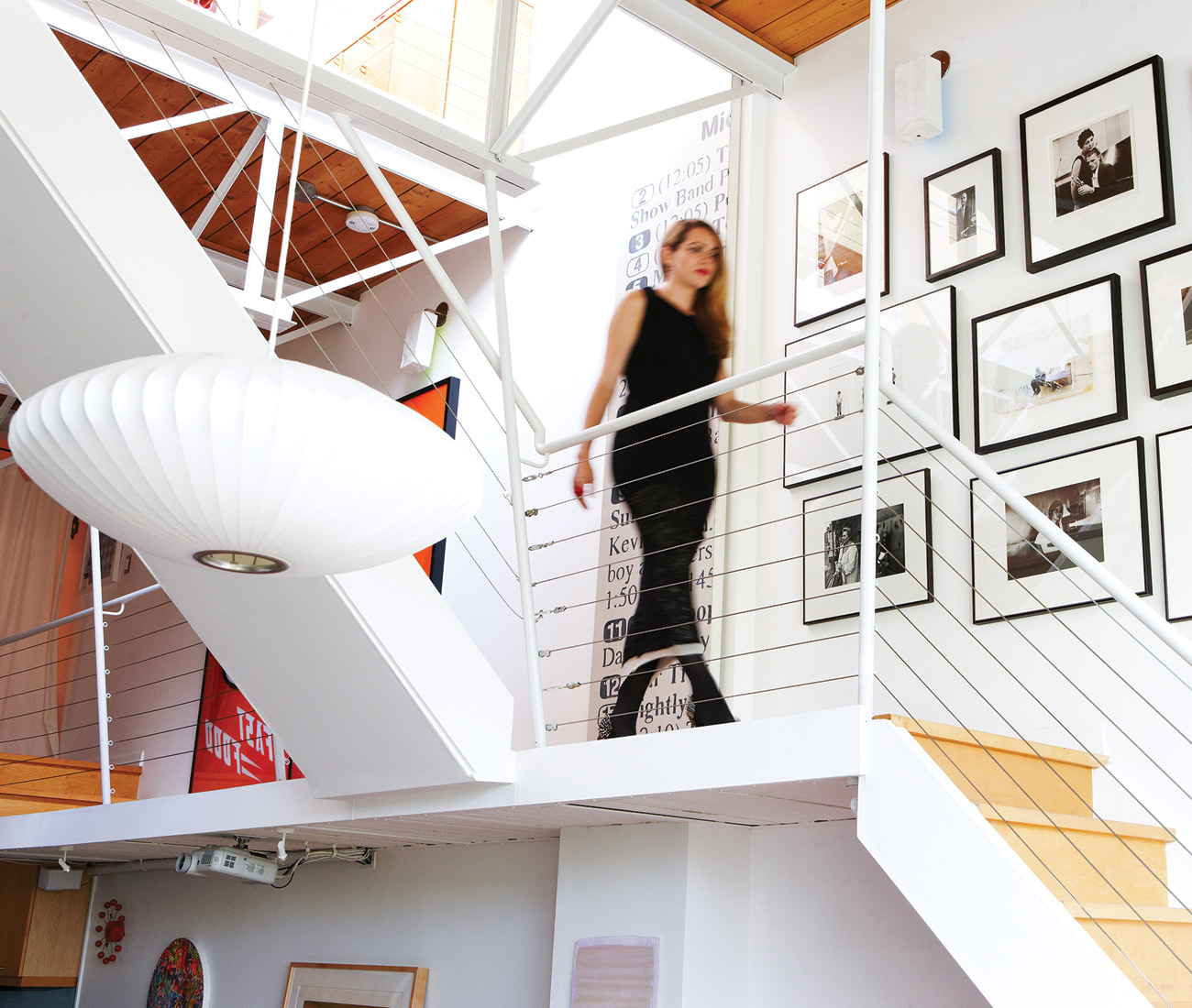 Steel beams reinforce the two upper floors and open-webbed steel joists support the stairs. Bain's collection of photos includes a portrait of Marshall McLuhan by John Reeves and a self-portrait of artist/activist Freda Guttman.