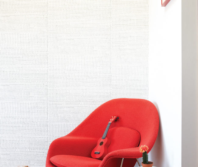 Kelly Mark's 12345 wallpaper, with its tight rows of tally marks, was the perfect choice for the upstairs office. Womb chair available at Design Within Reach; the Kartell side table can be found at Quasi Modo.