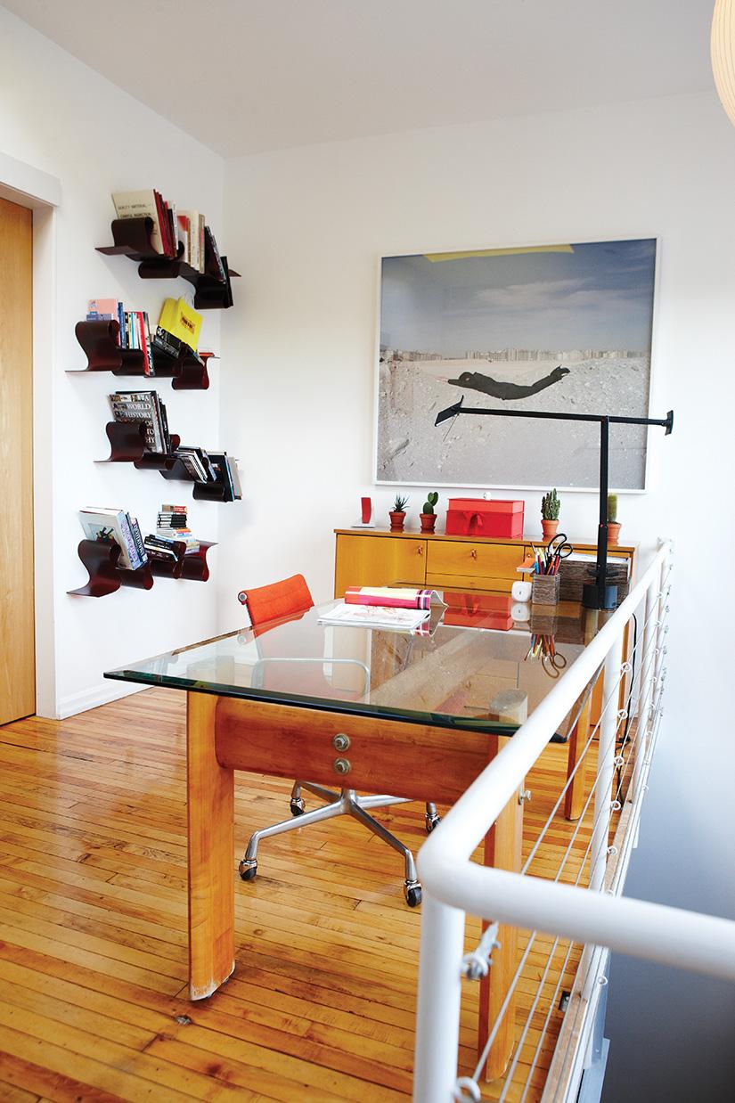 Kartell's Lovely Rita bookshelves, from Quasi Modo, cover one wall of Bain's office.