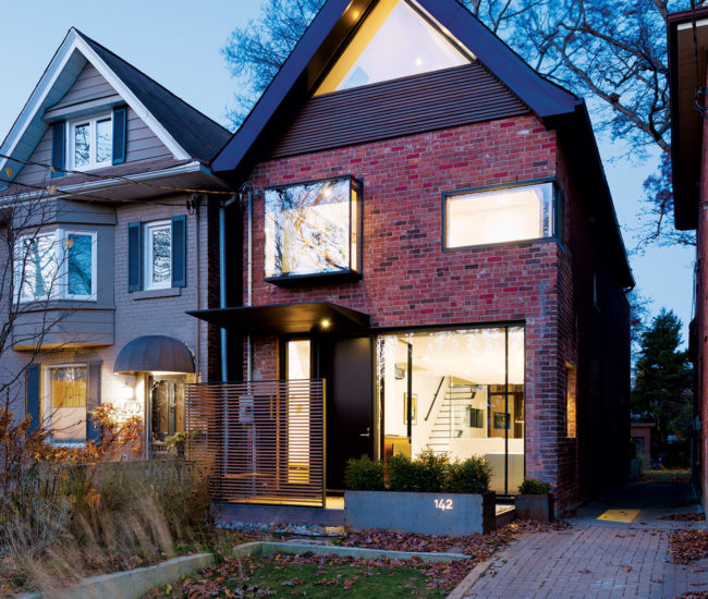 The house blends into the neighbourhood, yet stands out from it, thanks to surprising glass insertions.