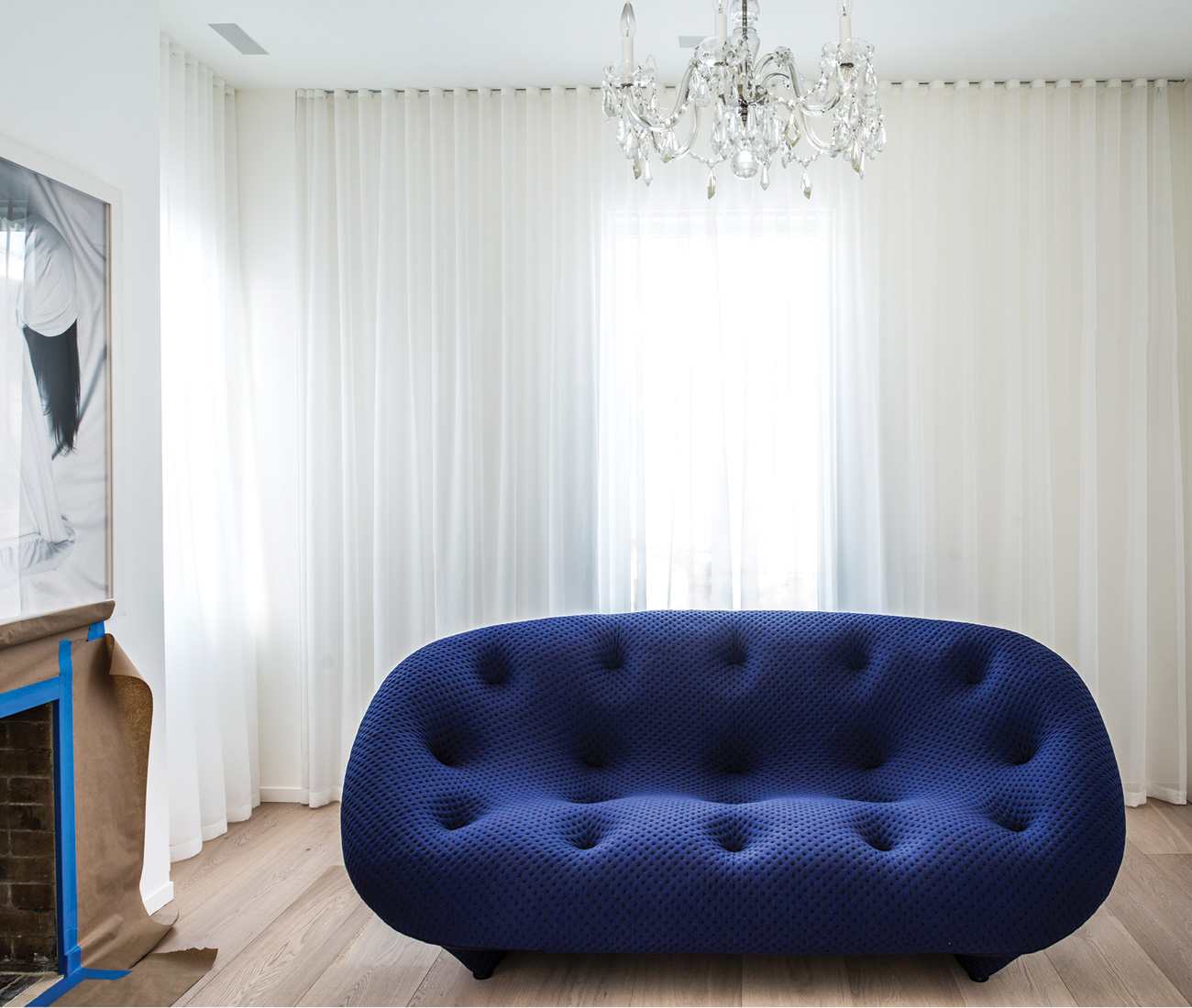 Ligne Roset's Ploum sofa by the Bouroullecs occupies the centre of the master suite's dressing room.