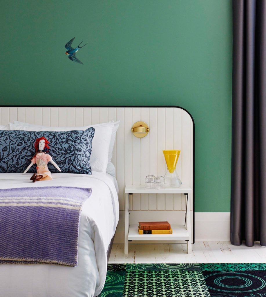 Rick Leong's bird mural soars above a +tongtong-designed bed. The headboard was manufactured by Coletech Quality Woodworking with painted MDF and bent-metal edging.