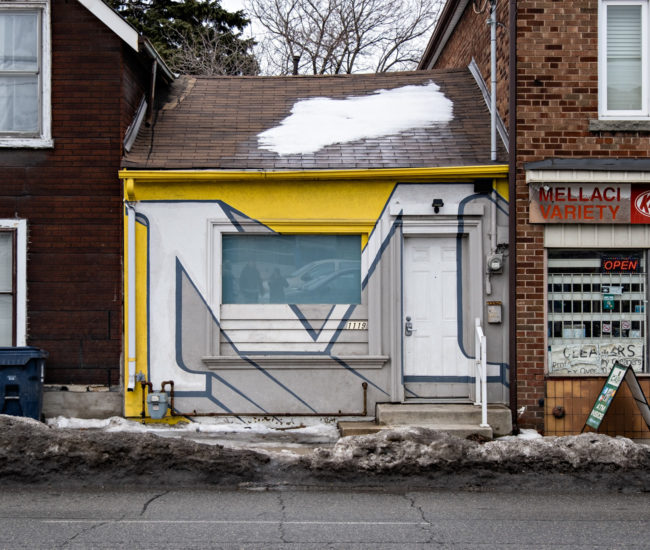 """This teeny house is a fixture of the Bloor andDufferin neighbourhood. The previous tenant, an artist, painted the now iconic """"M""""."""