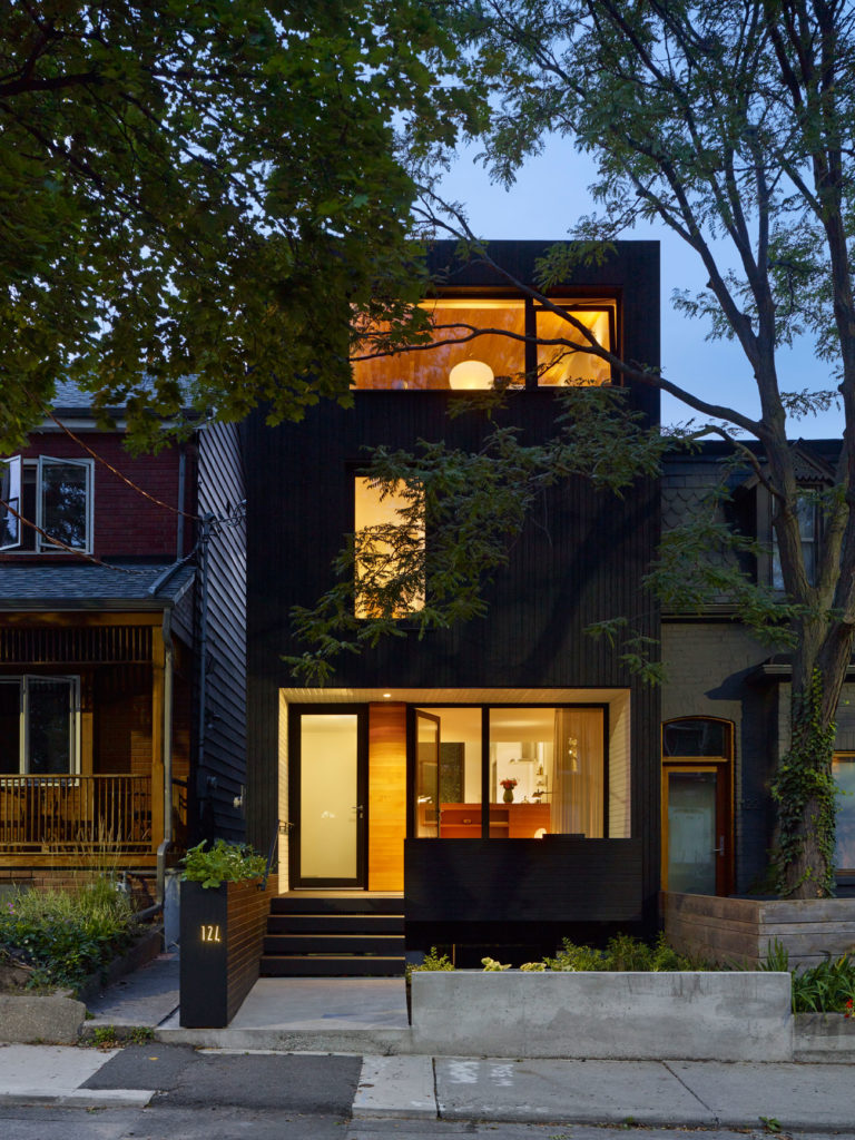 The three storey custom built home sits on a tree-lined street near Ossington. Photo by Tom Arban.