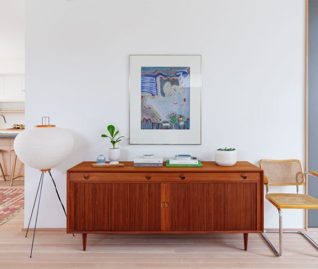 A Noguchi lamp illuminates the vintage furniture finds found throughout the house.