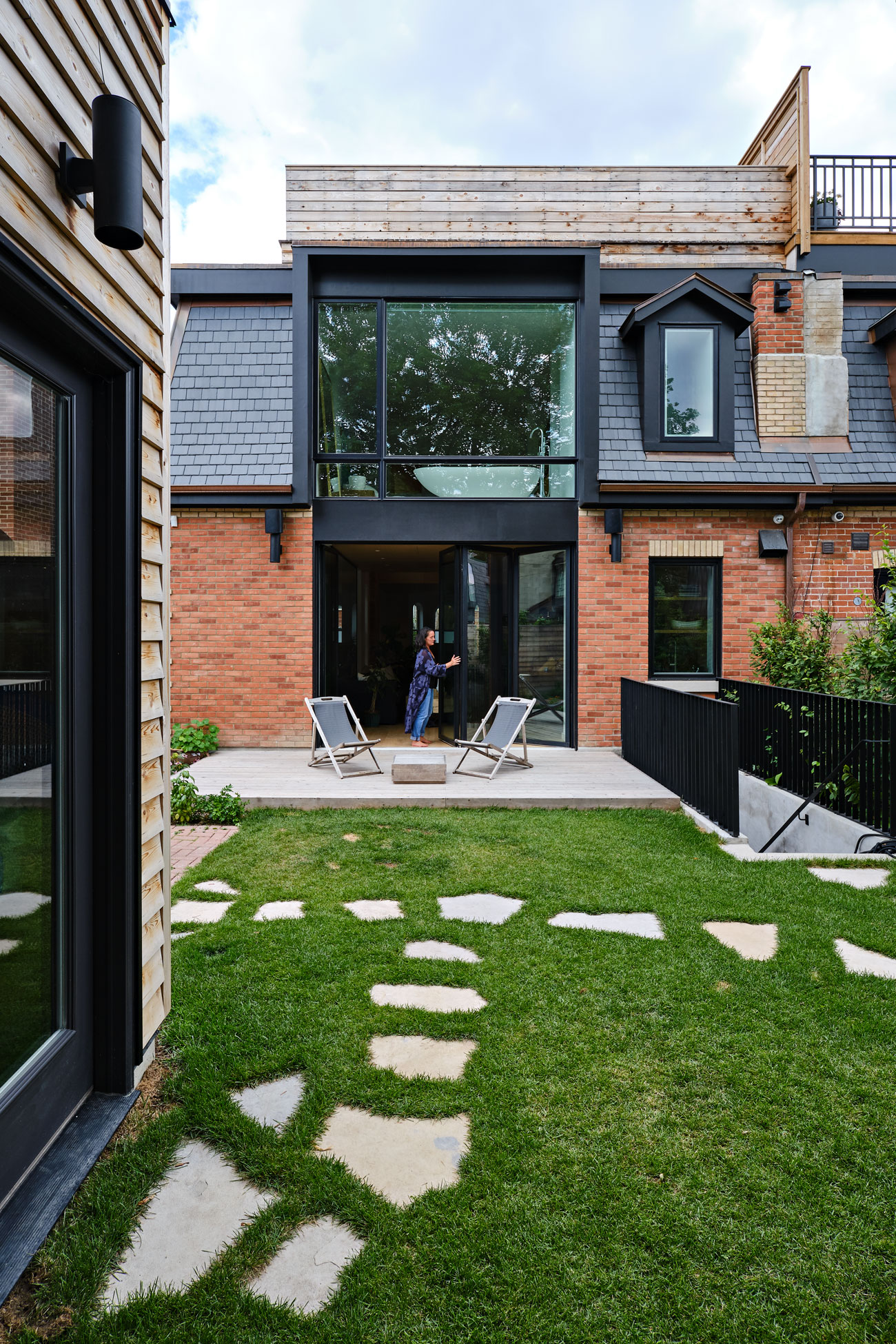 A view from the backyard shows the modern insertions to the heritage listed home by StudioAC.
