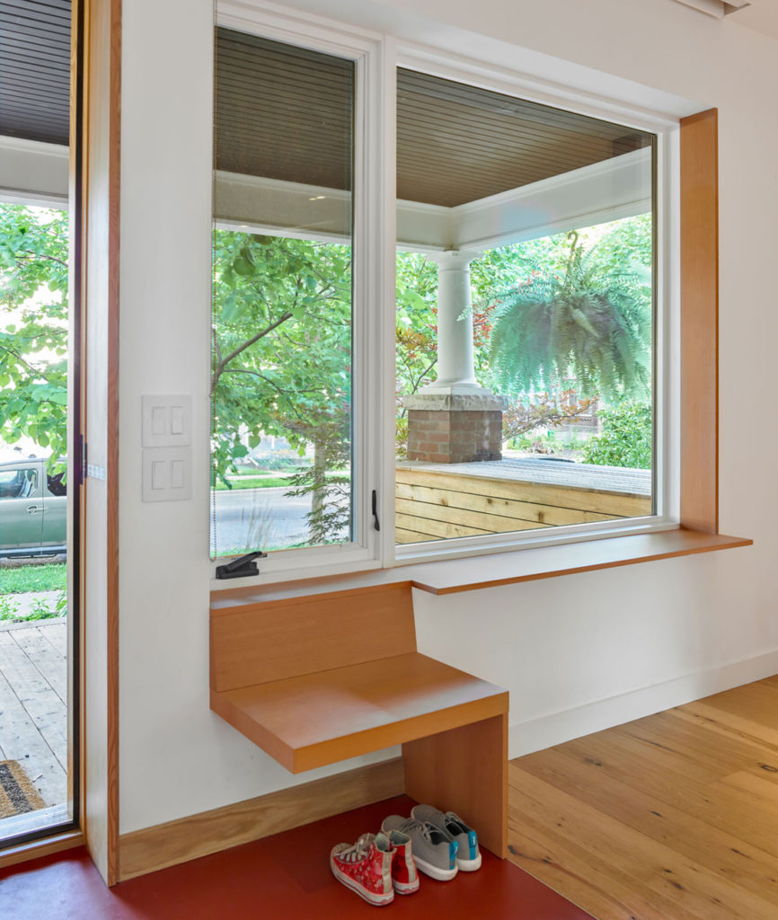 Red Forbo Marmoleum flooring is used in high-traffic areas, like the entry. The custom Douglas fir bench was built by Derek Nicholson. Windows and doors by Marvin.