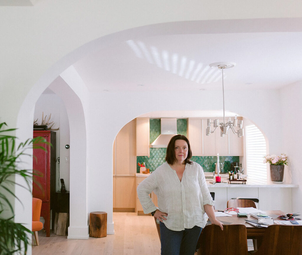 The beautiful, original arches in Deborah's home delineate kitchen, dining and living spaces.