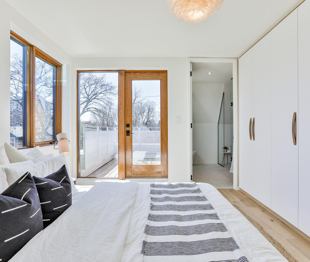 Up top, the master bedroom steps out to a rooftop deck; providing the perfect bird's eye view of the neighbourhood.