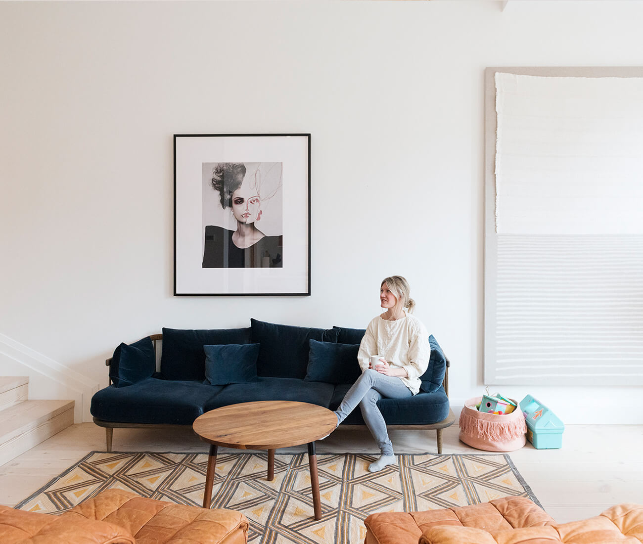 The artwork to the left is a collaboration between artist Tina Berning and photographer Michelangelo Di Battista. The large artwork to the right is by Alexander Jowett. Both are available at Alison Milne Co.