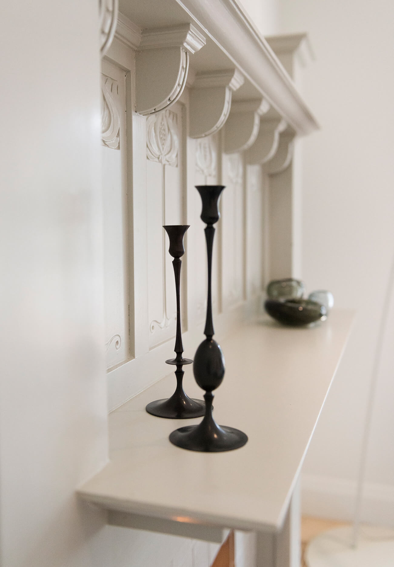 A detail shot of the refinished mantle. On it, candlesticks by Ted Muehling from Avenue Road.