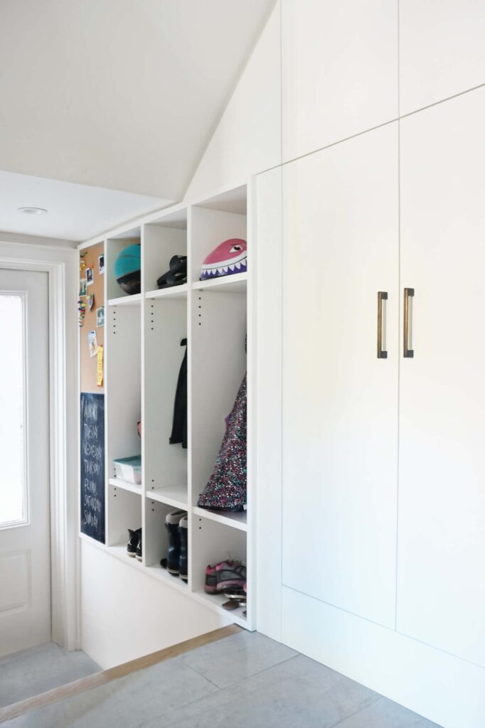 A well-trafficked side entrance features cubbies for each of the children, keeping the front entrance clutter-free and providing ample space for jackets, shoes and other outdoor necessities.
