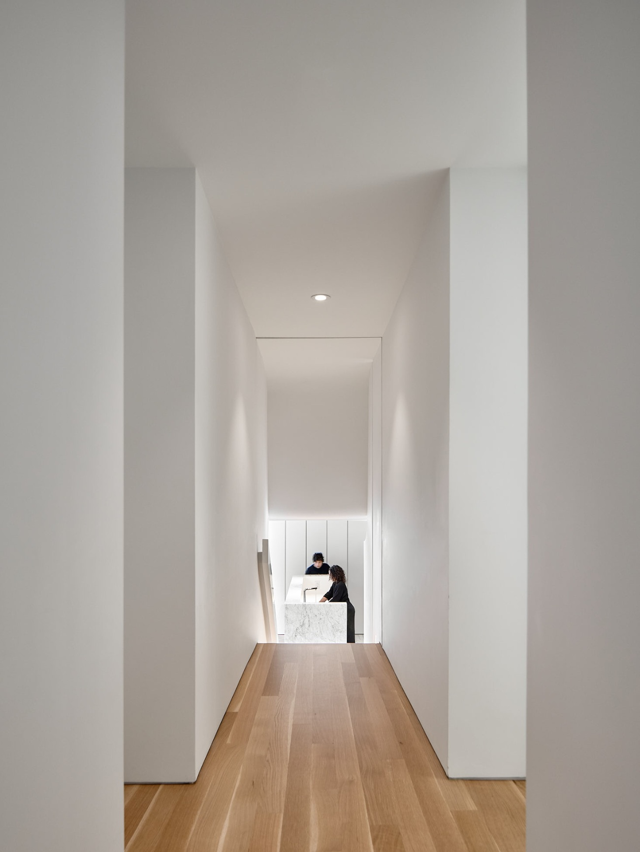The entrances to the bedrooms and bathrooms are set back from the corridor, making for a view unencumbered by closures.