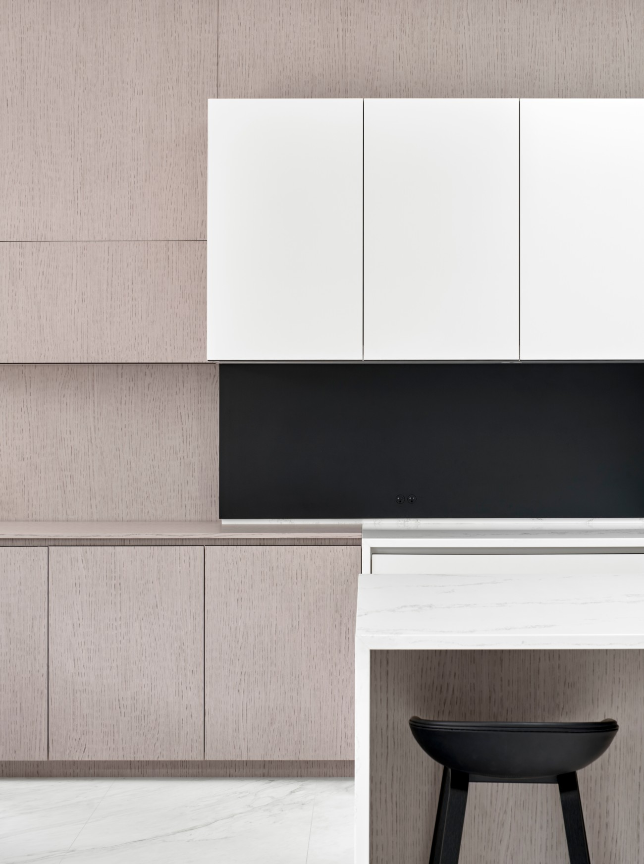 HanStone quartz surfaces and a powder-coated steel backsplash complement the home's high contrast motif.
