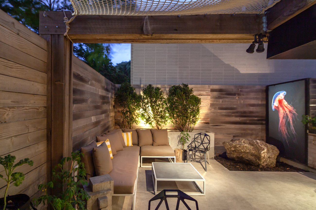 With plenty of seating and greenery, the backyard is an oasis-like setting in the heart of the city. The backlit jellyfish art takes on entirely new cast at night.