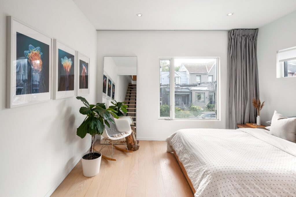 The guest bedroom gets plenty of light – and, if desired, fresh air – via a European-style turn-and-tilt fibreglass window, which are used throughout the home. Like the backyard, jellyfish art also features.