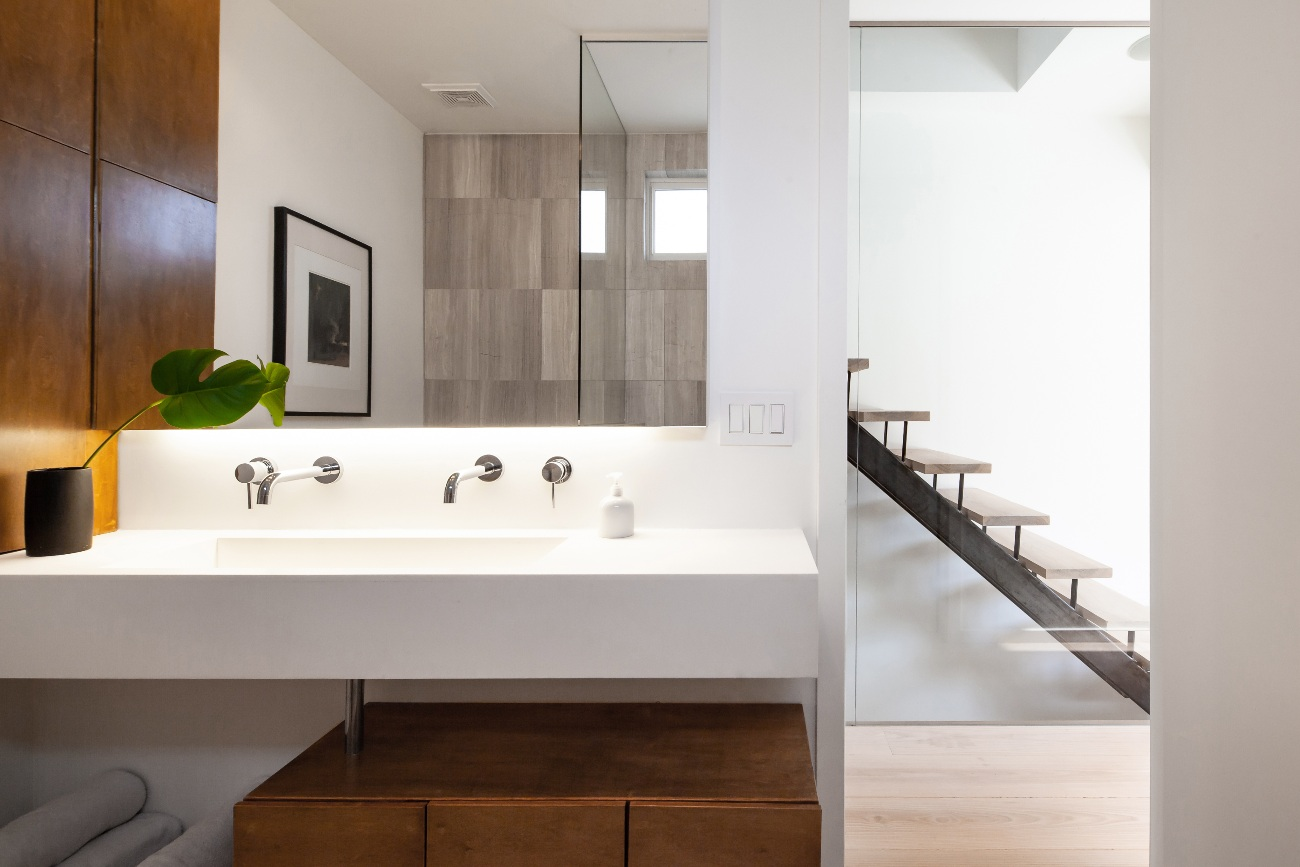 The cantilevered Corian sink is custom made and, for Jones, was a