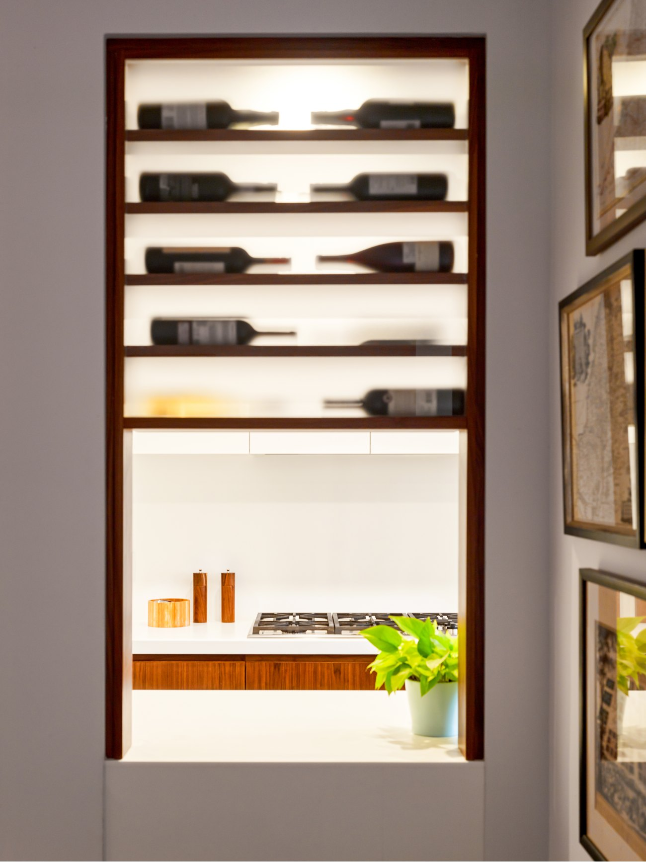 Originally a second entry into the dining room, the doorway has now been re-purposed as a wine rack and pass-through into the kitchen.