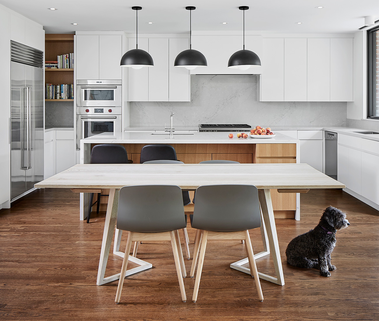 Kitchen dining chairs from Design Within Reach; faucets from Ginger's; expandable dining table by Cabinet.
