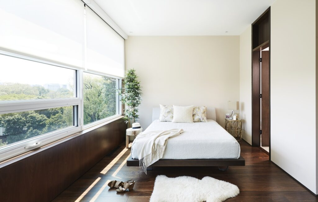 Engineered walnut (from The Floor Shop) runs throughout the third level, including the master bedroom and ensuite. Bed from Palazzetti.