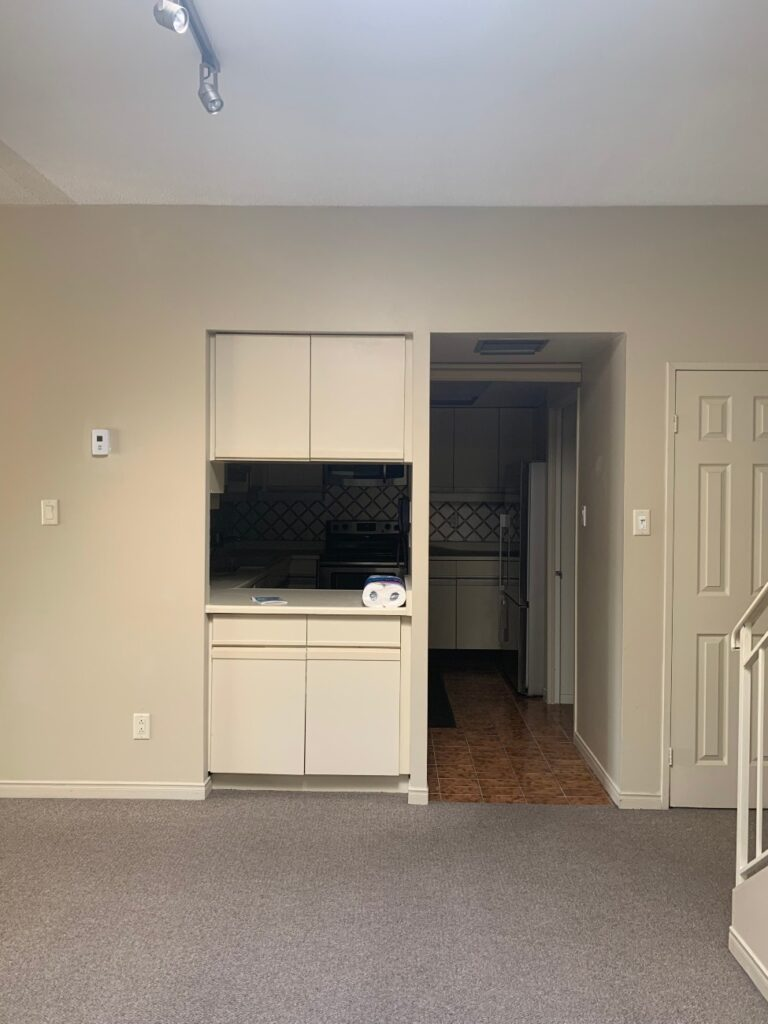 Before the reno, the kitchen was (unnecessarily) hemmed in, isolating it from the rest of the space.