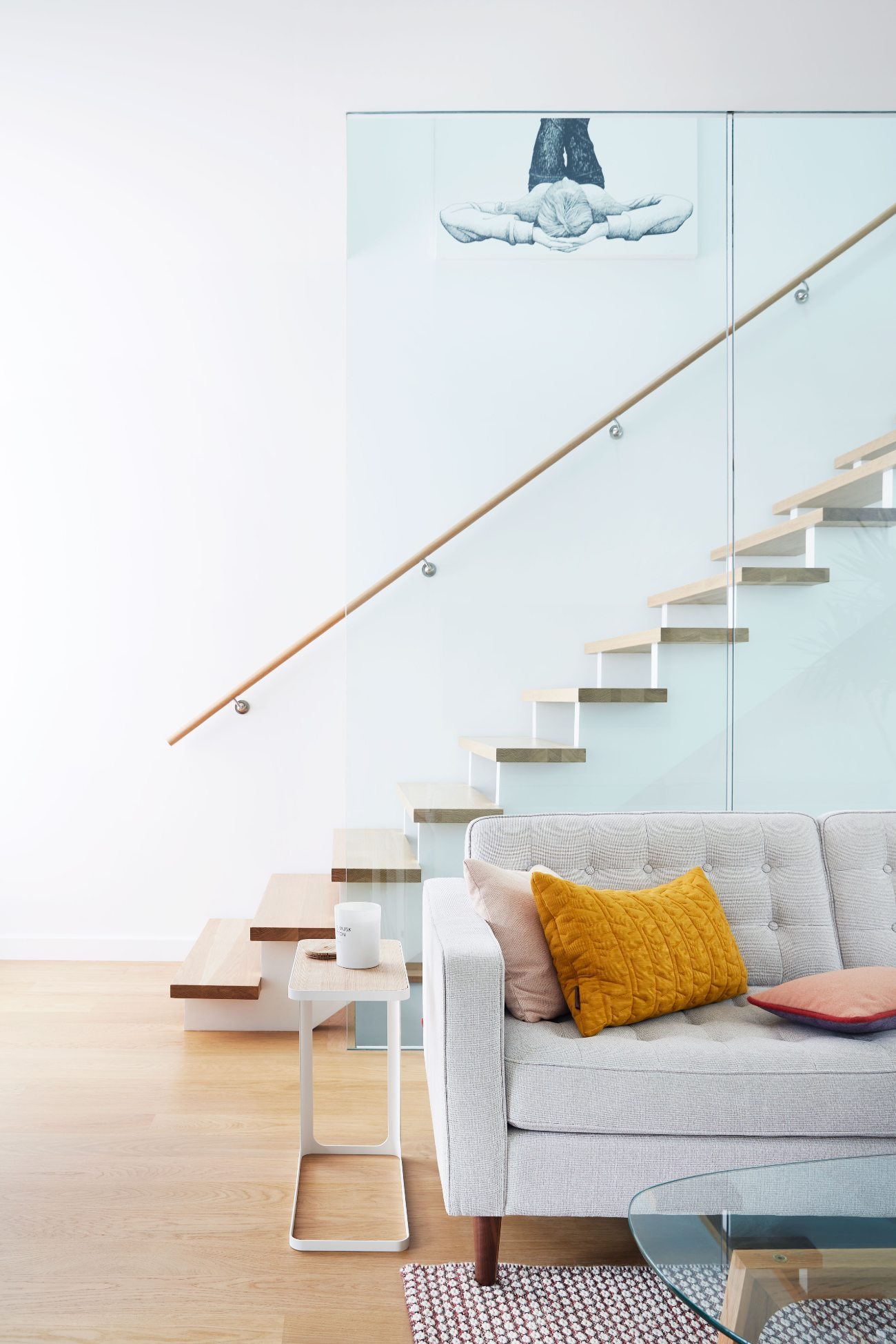 Enclosed by a glass wall and situated beneath a Velux skylight, the stairs now double as a lightwell.