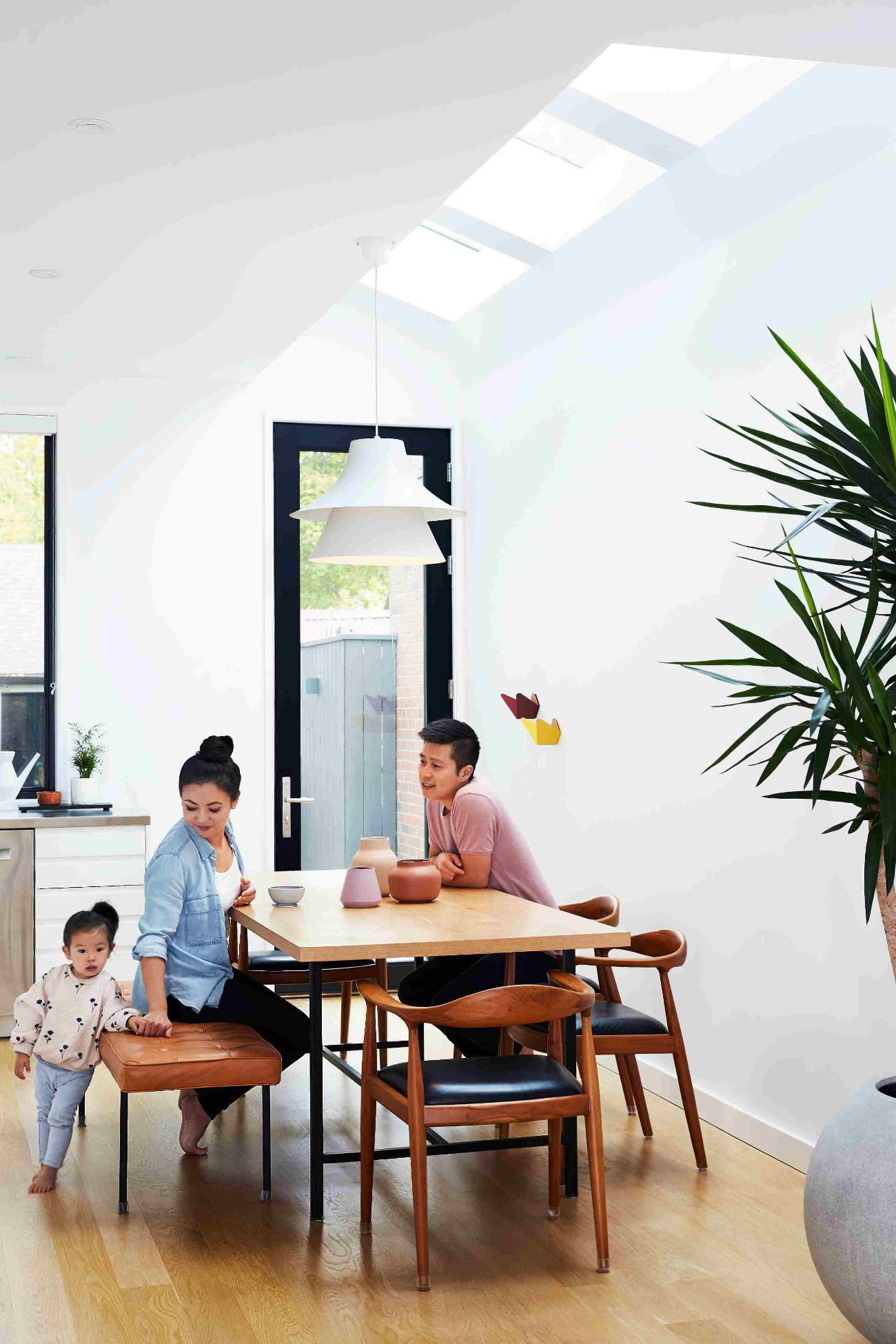 The new addition added a modest 6.5 square metres – and a skylight, by Velux – off the back corner of the home, transforming the kitchen into an eat-in.
