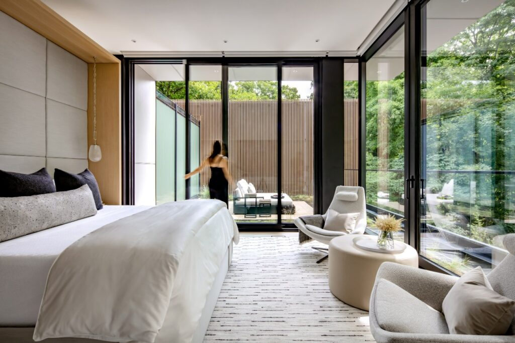 A private rooftop terrace is accessible from the main bedroom. Sliding door by Alumilex; Restoration Hardware daybed.