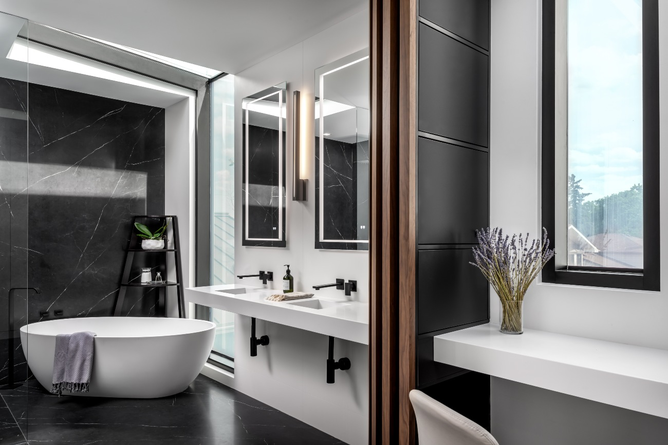 The black and white tiled surfaces are by Porcelanosa. Tub by Blu Bathworks; fixtures by Graff.