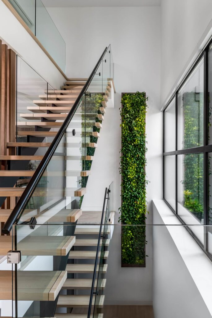 The green wall features its own water management system and –aside from the occasional dead plant – is self-sustaining.